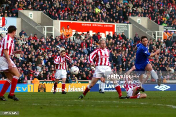 Chelsea's Frank Lampard gets in a shot despite a tackle from Stoke City's James O'Connor