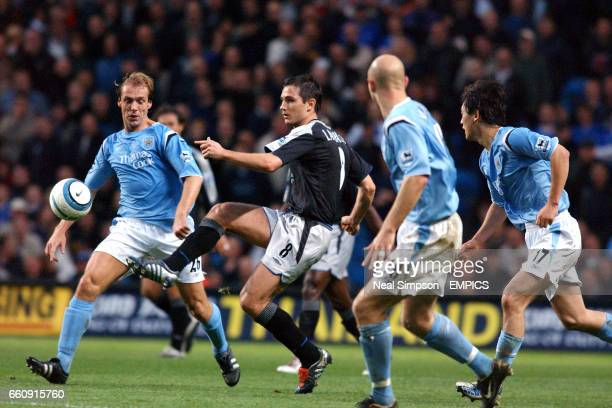 Chelsea's Frank Lampard gets in a shot despite the close attentions of Manchester City's Paul Bosvelt Danny Mills and Jihai Sun
