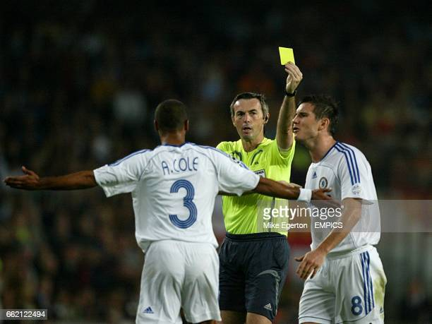 Chelsea's Frank Lampard is booked by referee Stefano Farina as Ashley Cole appeals