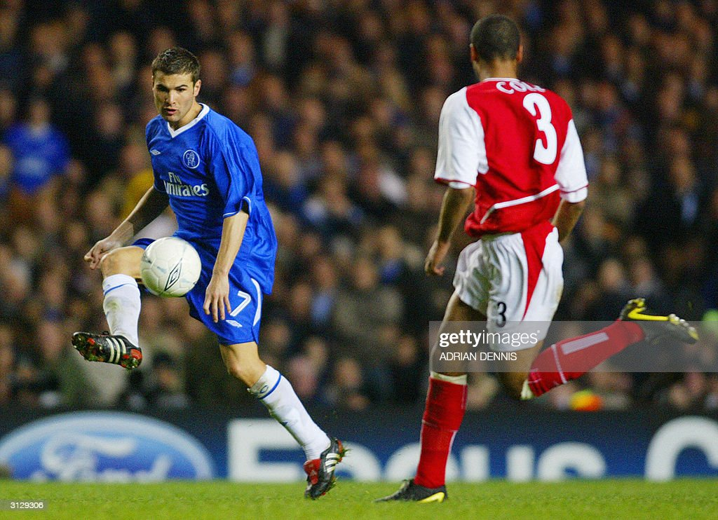 Chelsea's Frank Lampard (L) is followed by Arsenal's Ashely Cole during their Champions League quarter-final football match 24 March, 2004 at Stamford Bridge, London. Chelsea and Arsenal tied 1-1.