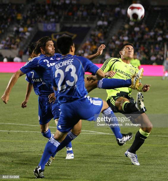 Chelsea's Frank Lampard is stopped by Blue Wings Eduardo during a Friendly match at The Home Depot Center Los Angeles USA