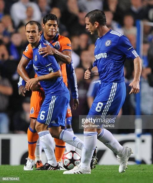 Chelsea's Frank Lampard passes the ball to team mate Ricardo Carvalho who is held back by FC Porto's Givaldinho Hulk
