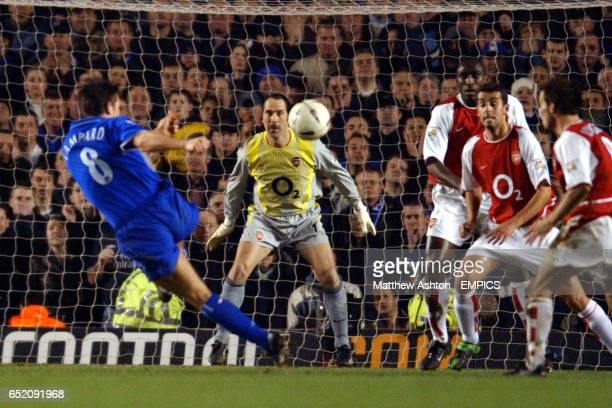 Chelsea's Frank Lampard shoots from distance as the Arsenal defence look on