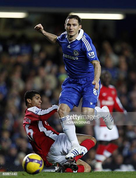Chelsea's Frank Lampard skips over a challenge from Arsenal's Brazilian player Denilson during the Premiership match at Stamford Bridge in London on...