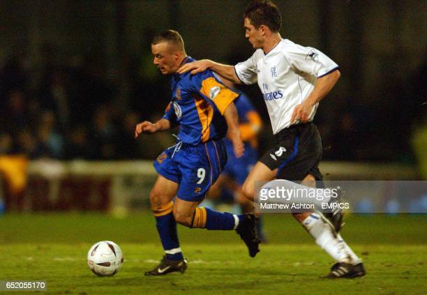 Chelsea's Frank Lampard tries to stop Shrewsbury Town's Luke Rodgers