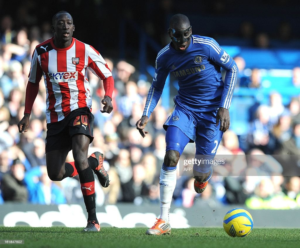 "Chelsea's French Born Senegalese player Demba Ba (R) vies with Brentford's French player Toumani Diagouraga during the fourth round replay English FA Cup football match between Chelsea and Brentford at Stamford Bridge in London on February 17, 2013. Chelsea won 4-0. AFP PHOTO/OLLY GREENWOOD - RESTRICTED TO EDITORIAL USE. No use with unauthorized audio, video, data, fixture lists, club/league logos or ""live"" services. Online in-match use limited to 45 images, no video emulation. No use in betting, games or single club/league/player publications."