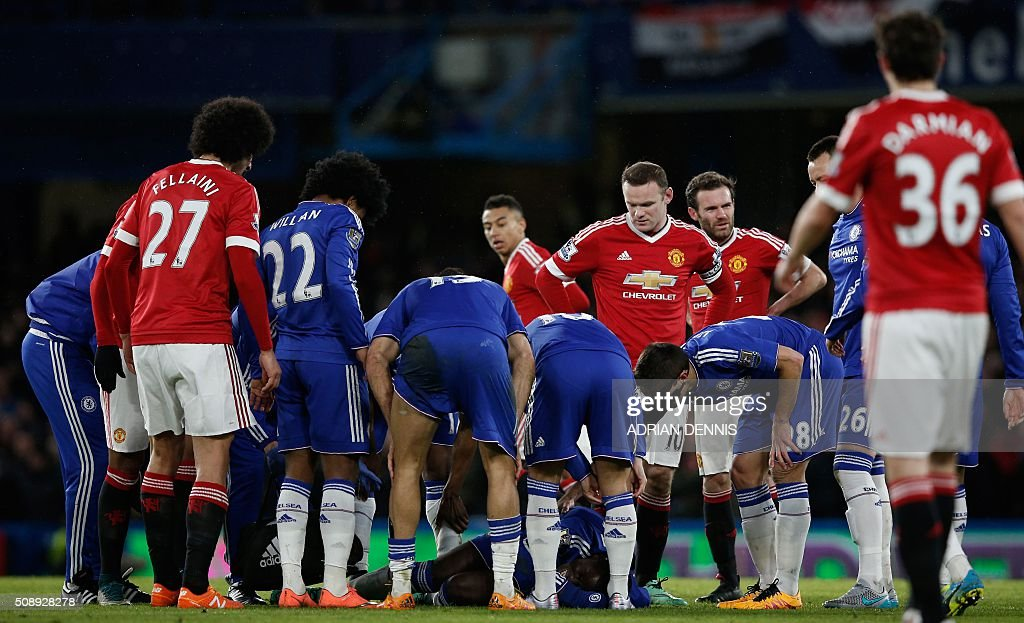 Chelsea's French defender Kurt Zouma (C) lies injured during the English Premier League football match between Chelsea and Manchester United at Stamford Bridge in London on February 7, 2016. / AFP / ADRIAN DENNIS / RESTRICTED TO EDITORIAL USE. No use with unauthorized audio, video, data, fixture lists, club/league logos or 'live' services. Online in-match use limited to 75 images, no video emulation. No use in betting, games or single club/league/player publications. /