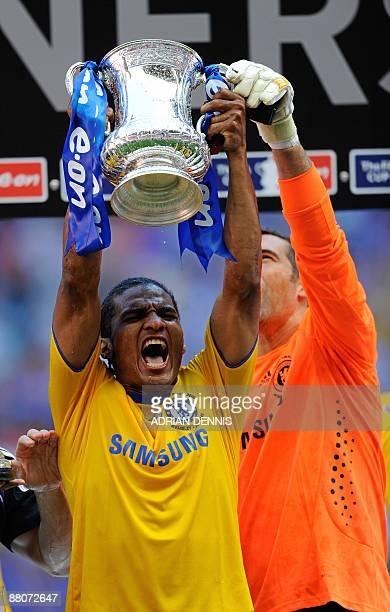 Chelsea's French footballer Florent Malouda celebrates with the FA Cup beating Everton 21 in the FA Cup final at Wembley in north Londonon May 30...