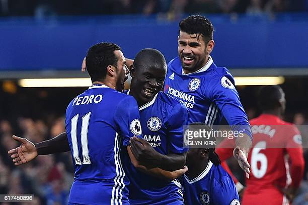Chelsea's French midfielder N'Golo Kante celebrates scoring their fourth goal during the English Premier League football match between Chelsea and...