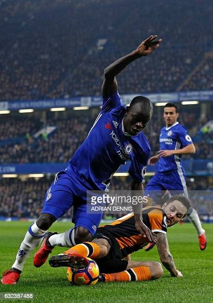 Chelsea's French midfielder N'Golo Kante is tackled by Hull City's English midfielder Ryan Mason during the English Premier League football match...