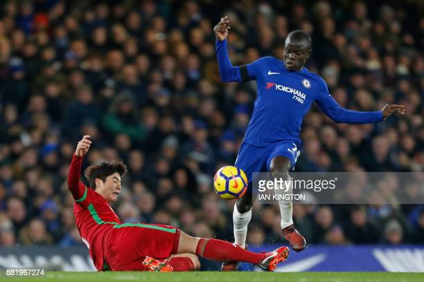 Chelsea's French midfielder N'Golo Kante is tackled by Swansea City's South Korean midfielder Ki SungYueng during the English Premier League football...