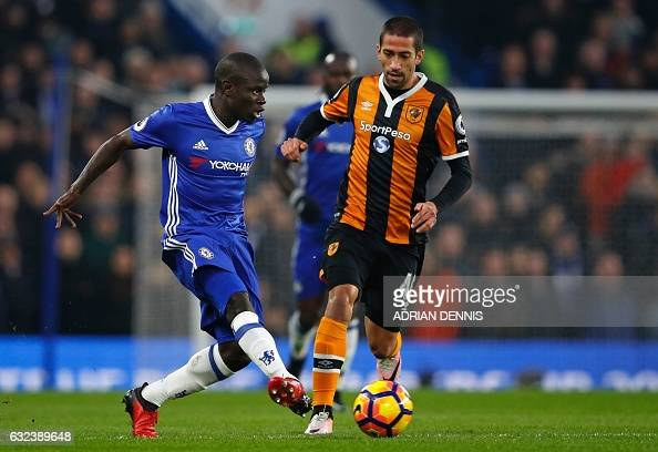 Chelsea's French midfielder N'Golo Kante passes the ball during the English Premier League football match between Chelsea and Hull City at Stamford...