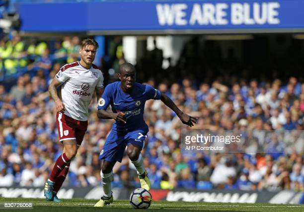 Chelsea's French midfielder N'Golo Kante runs with the ball during the English Premier League football match between Chelsea and Burnley at Stamford...
