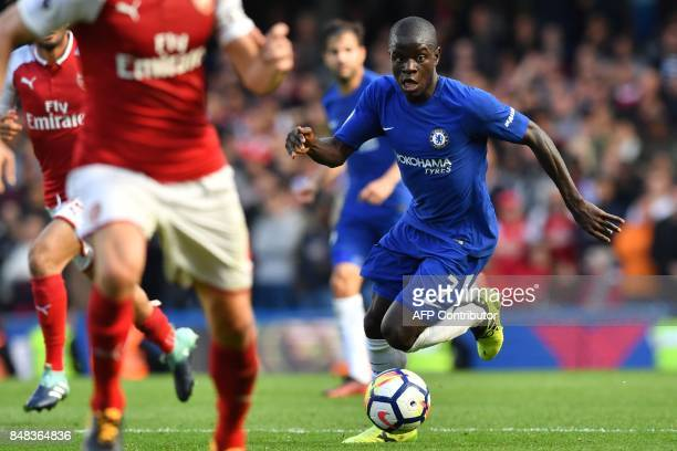 Chelsea's French midfielder N'Golo Kante runs with the ball during the English Premier League football match between Chelsea and Arsenal at Stamford...