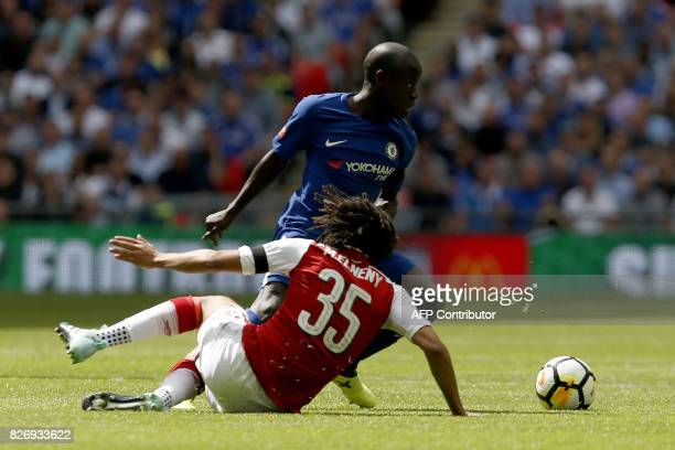 Chelsea's French midfielder N'Golo Kante vies with Arsenal's Egyptian midfielder Mohamed Elneny during the English FA Community Shield football match...