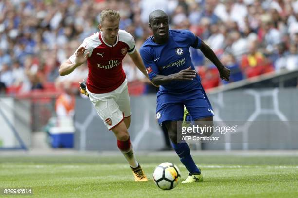 Chelsea's French midfielder N'Golo Kante vies with Arsenal's English defender Rob Holding during the English FA Community Shield football match...