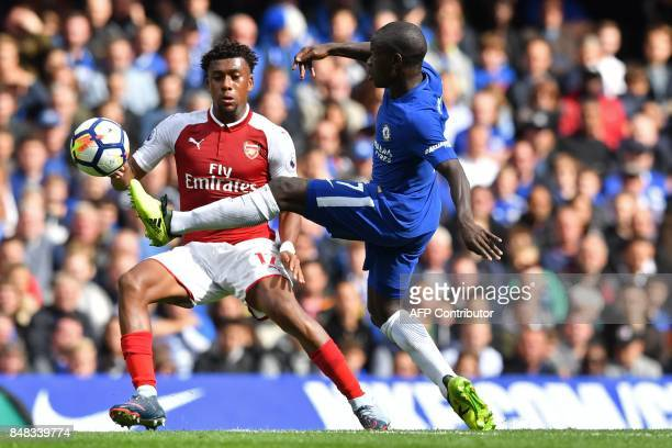 Chelsea's French midfielder N'Golo Kante vies with Arsenal's Nigerian striker Alex Iwobi during the English Premier League football match between...