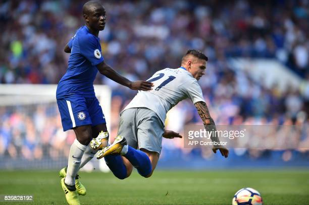 Chelsea's French midfielder N'Golo Kante vies with Everton's Germanborn Bosnian midfielder Muhamed Besic during the English Premier League football...