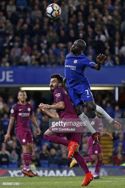 Chelsea's French midfielder N'Golo Kante vies with Manchester City's German midfielder Ilkay Gundogan during the English Premier League football...