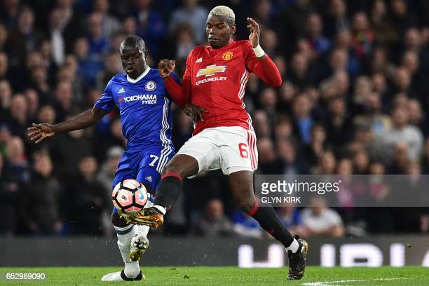 Chelsea's French midfielder N'Golo Kante vies with Manchester United's French midfielder Paul Pogba during the English FA Cup quarter final football...