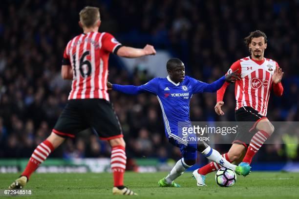 Chelsea's French midfielder N'Golo Kante vies with Southampton's English midfielder James WardProwse and Southampton's Italian striker Manolo...