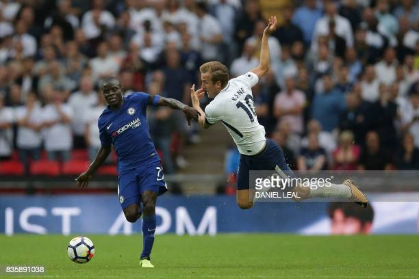 Chelsea's French midfielder N'Golo Kante vies with Tottenham Hotspur's English striker Harry Kane during the English Premier League football match...