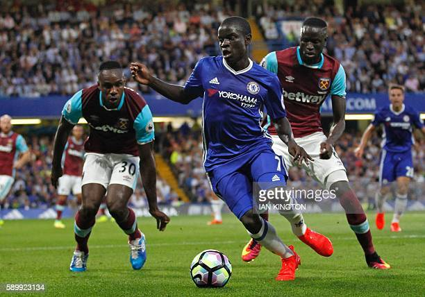 Chelsea's French midfielder N'Golo Kante vies with West Ham United's English midfielder Michail Antonio and West Ham United's Senegalese midfielder...