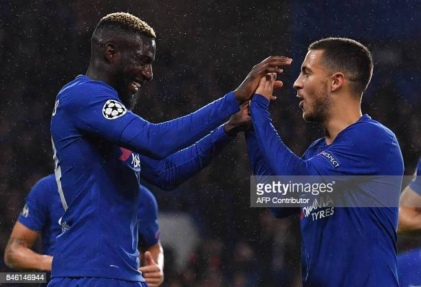 Chelsea's French midfielder Tiemoue Bakayoko celebrates scoring his team's fourth goal with Chelsea's Belgian midfielder Eden Hazard during the UEFA...