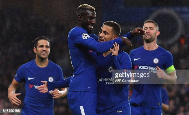 Chelsea's French midfielder Tiemoue Bakayoko celebrates scoring his team's fourth goal with Chelsea's Belgian midfielder Eden Hazard during the UEFA...