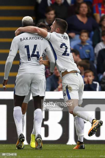 Chelsea's French midfielder Tiemoue Bakayoko celebrates with teammates after scoring their first goal during the English Premier League football...