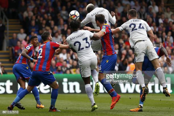 Chelsea's French midfielder Tiemoue Bakayoko jumps to haed Chelsea's first goal during the English Premier League football match between Crystal...