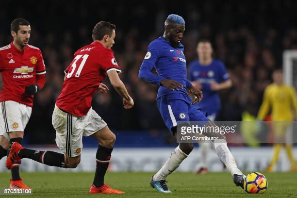 Chelsea's French midfielder Tiemoue Bakayoko passes the ball during the English Premier League football match between Chelsea and Manchester United...