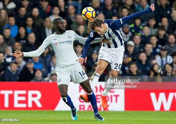 Chelsea's French midfielder Tiemoue Bakayoko vies with West Bromwich Albion's Polish midfielder Grzegorz Krychowiak during the English Premier League...