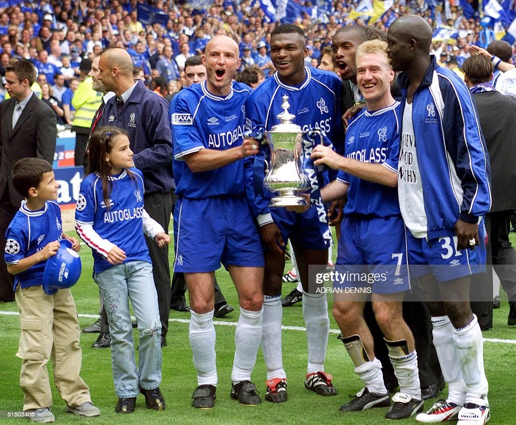 Chelsea's French players Franck Leboeuf (C), Marcel Desailly (3rd right) Didier Deschamps (2nd right) and Liberian George Weah (R) celebrate with some of the players' children after winning the F.A Cup final at Wembley 20 May 2000. Chelsea defeated Aston Villa 1-0 with a late strike from Roberto Di Matteo. ELECTRONIC IMAGE