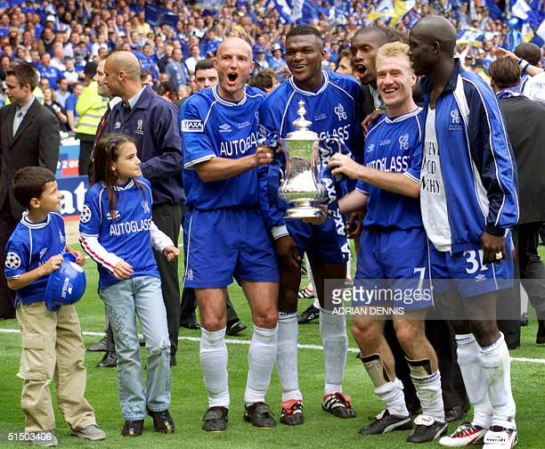 Chelsea's French players Franck Leboeuf Marcel Desailly Didier Deschamps and Liberian George Weah celebrate with some of the players' children after...