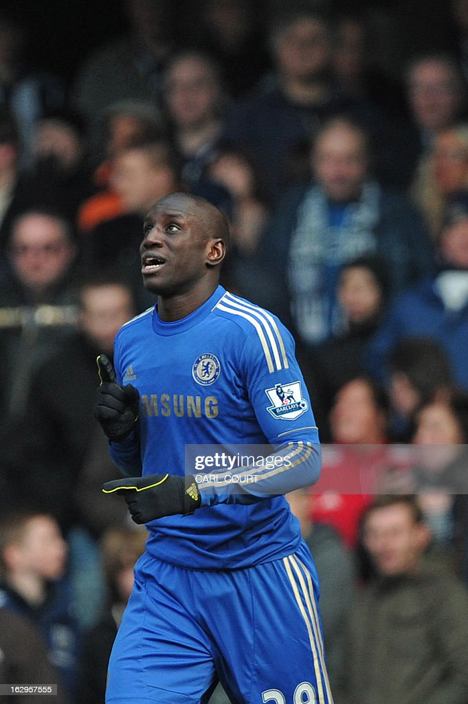 Chelsea's French-born Senegalese striker Demba Ba celebrates after scoring the opening goal of the English Premier League football match between Chelsea and West Bromwich Albion at Stamford Bridge in London on March 2, 2013. USE. No use with unauthorized audio, video, data, fixture lists, club/league logos or 'live' services. Online in-match use limited to 45 images, no video emulation. No use in betting, games or single club/league/player publications.