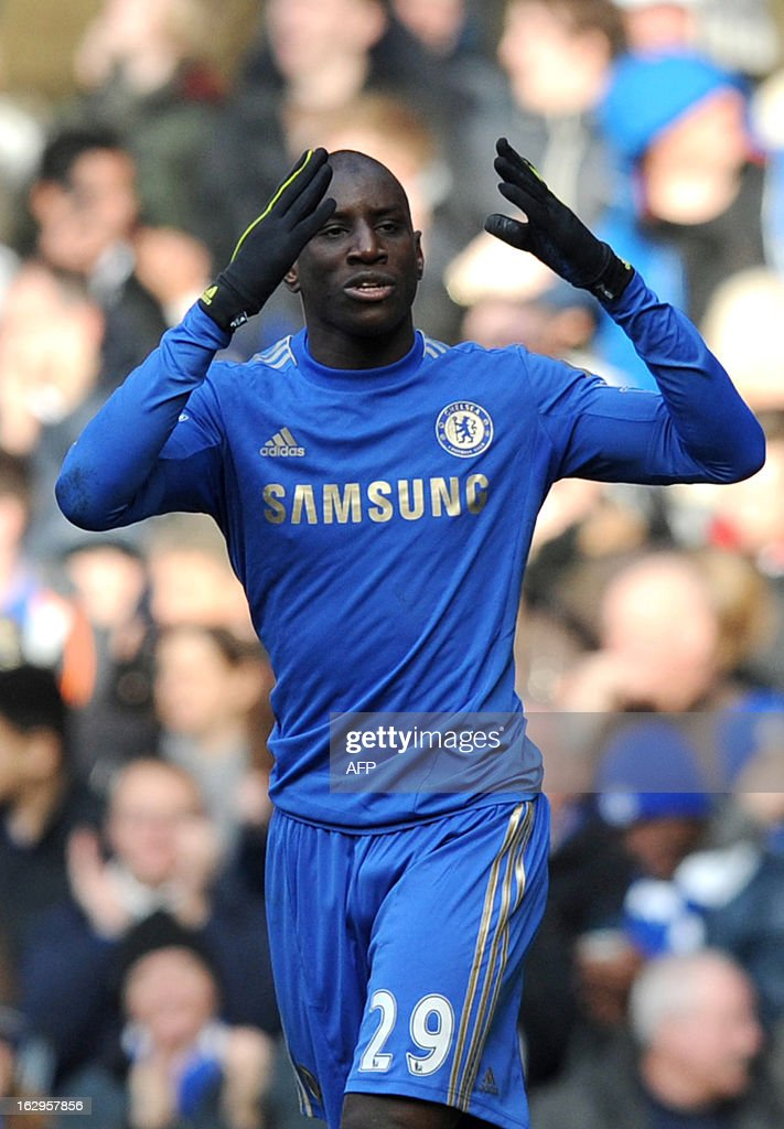 Chelsea's French-born Senegalese striker Demba Ba celebrates scoring against West Bromwich Albionduring the English Premier League football match between Chelsea and West Brom at Stamford Bridge in London on March 2, 2013. USE. No use with unauthorized audio, video, data, fixture lists, club/league logos or 'live' services. Online in-match use limited to 45 images, no video emulation. No use in betting, games or single club/league/player publications.