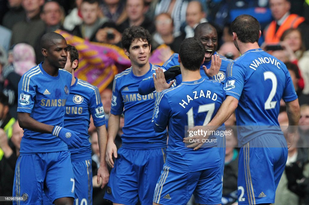 Chelsea's French-born Senegalese striker Demba Ba (2nd R) celebrates with teammates after scoring the opening goal of the English Premier League football match between Chelsea and West Bromwich Albion at Stamford Bridge in London on March 2, 2013. USE. No use with unauthorized audio, video, data, fixture lists, club/league logos or 'live' services. Online in-match use limited to 45 images, no video emulation. No use in betting, games or single club/league/player publications.
