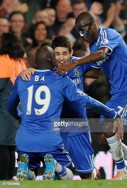Chelsea's Frenchborn Senegalese striker Demba Ba celebrates with Brazilian midfielder Oscar and Brazilian midfielder Ramires after his goal during...