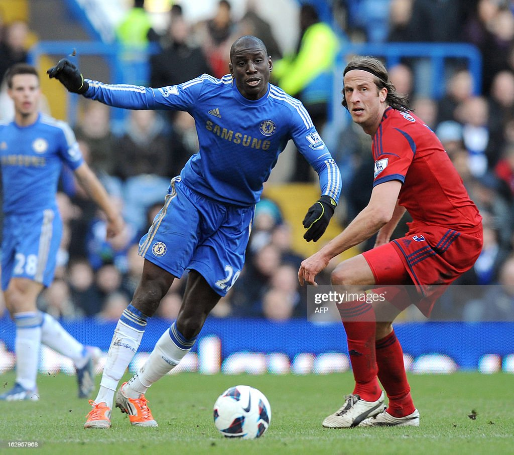Chelsea's French-born Senegalese striker Demba Ba (L) is challenged by West Bromwich Albion's Swedish defender Jonas Olsson during the English Premier League football match between Chelsea and West Brom at Stamford Bridge in London on March 2, 2013. USE. No use with unauthorized audio, video, data, fixture lists, club/league logos or 'live' services. Online in-match use limited to 45 images, no video emulation. No use in betting, games or single club/league/player publications.