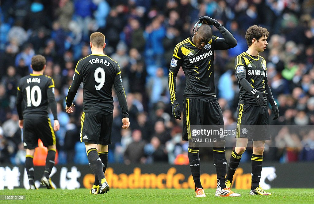 """Chelsea's French-born Senegalese striker Demba Ba (2R) removes his protective face-mask after the final whistle in their 2-0 defeat in the English Premier League football match between Manchester City and Chelsea at the Etihad Stadium in Manchester, northwest England, on February 24, 2013. Man City won 2-0. USE. No use with unauthorized audio, video, data, fixture lists, club/league logos or """"live"""" services. Online in-match use limited to 45 images, no video emulation. No use in betting, games or single club/league/player publications."""
