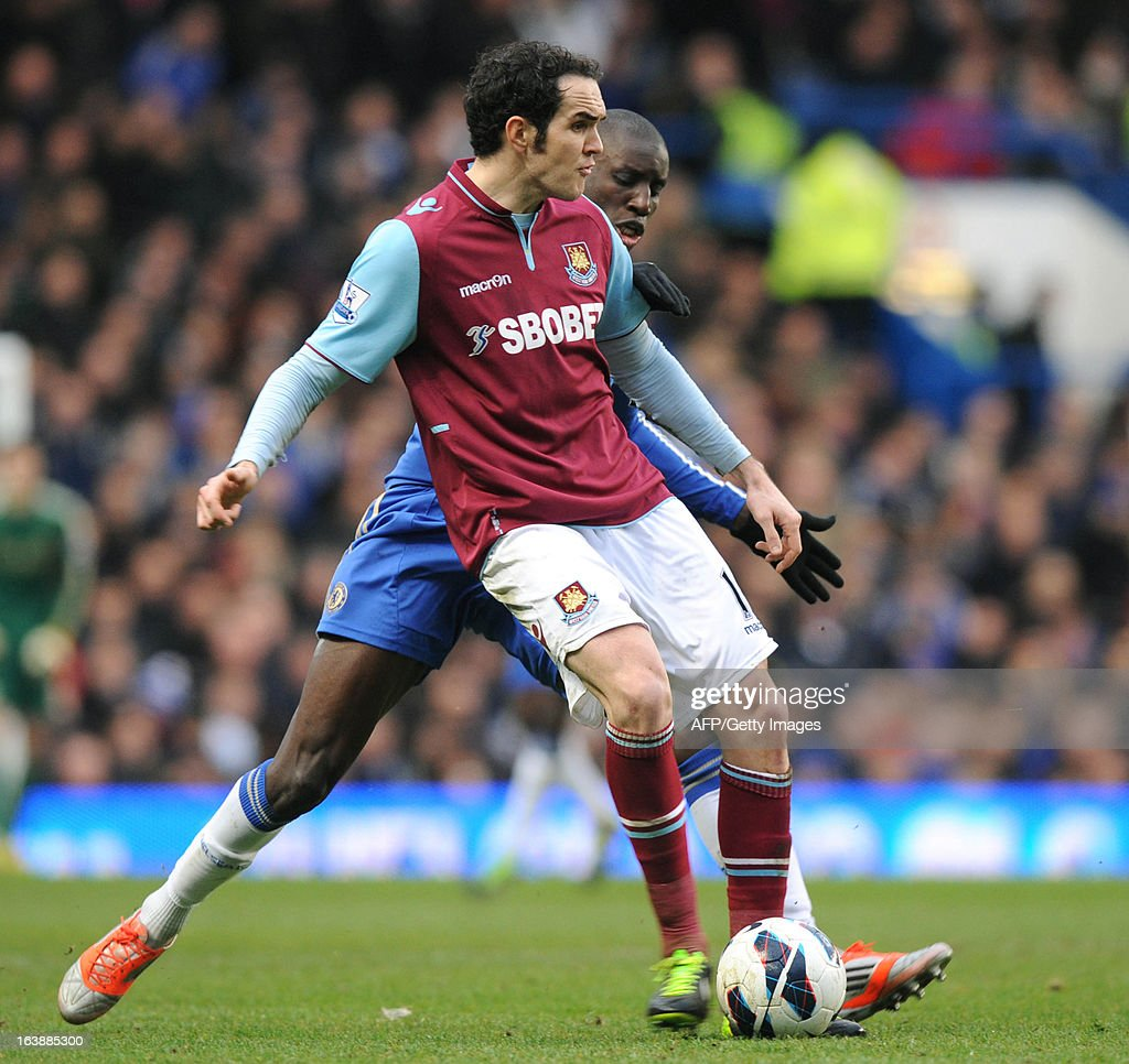 """Chelsea's French-born Senegalese striker Demba Ba (R) vies with West Ham United's Welsh midfielder Jack Collison (L) during the English Premier League football match between Chelsea and West Ham United at Stamford Bridge in London on March 17, 2013. USE. No use with unauthorized audio, video, data, fixture lists, club/league logos or """"live"""" services. Online in-match use limited to 45 images, no video emulation. No use in betting, games or single club/league/player publications."""