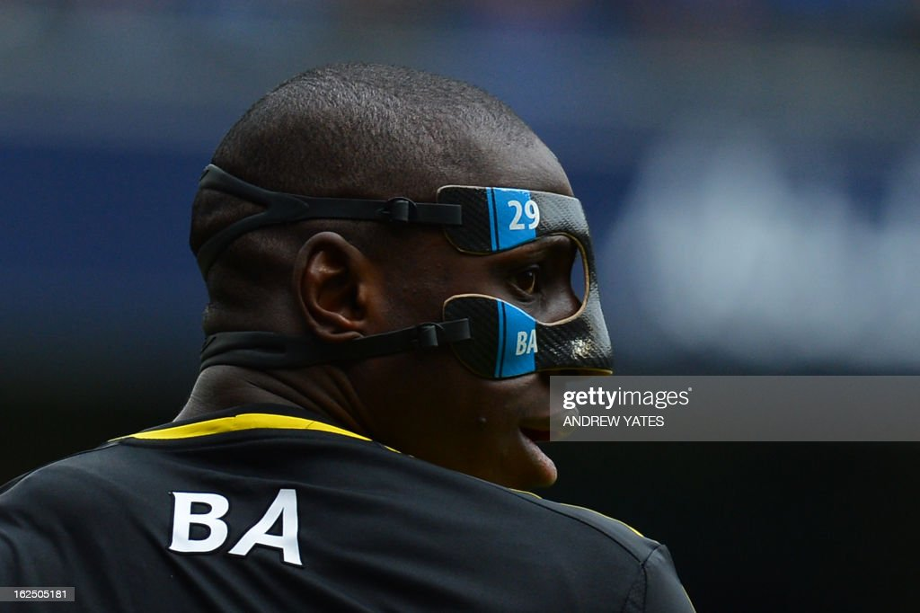 "Chelsea's French-born Senegalese striker Demba Ba wearing a protective face mask during the English Premier League football match between Manchester City and Chelsea at the Etihad Stadium in Manchester, northwest England, on February 24, 2013. USE. No use with unauthorized audio, video, data, fixture lists, club/league logos or ""live"" services. Online in-match use limited to 45 images, no video emulation. No use in betting, games or single club/league/player publications."