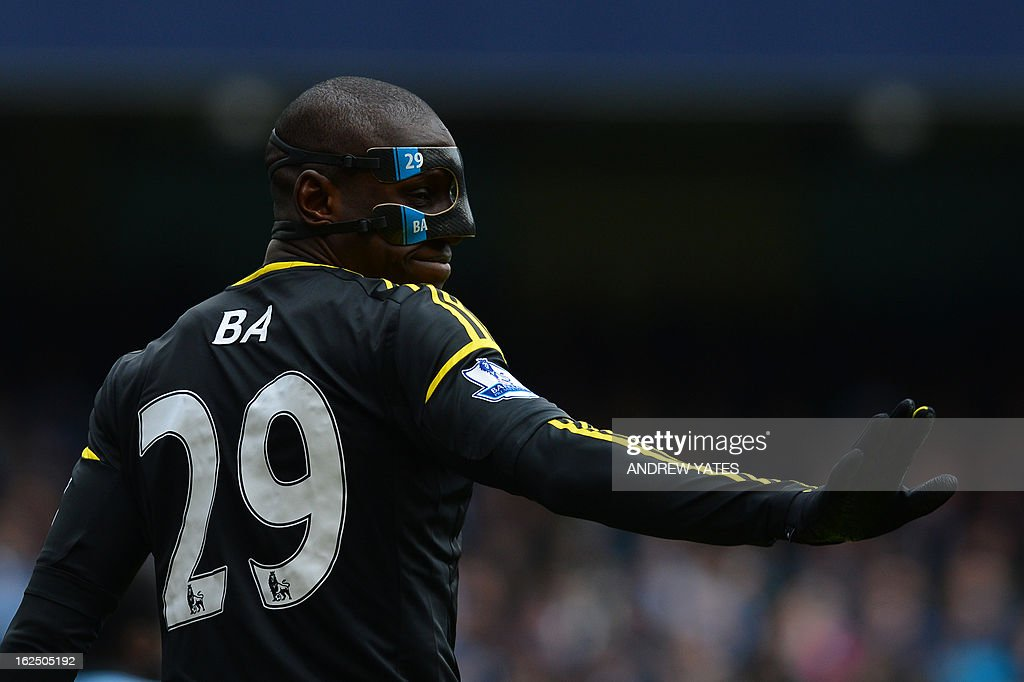 """Chelsea's French-born Senegalese striker Demba Ba wearing a protective face mask during the English Premier League football match between Manchester City and Chelsea at the Etihad Stadium in Manchester, northwest England, on February 24, 2013. USE. No use with unauthorized audio, video, data, fixture lists, club/league logos or """"live"""" services. Online in-match use limited to 45 images, no video emulation. No use in betting, games or single club/league/player publications."""