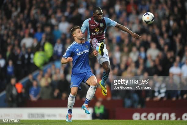 Chelsea's Gary Cahill and Aston Villa's Christian Benteke battle for the ball during the Barclays Premier League match at Villa Park Birmingham