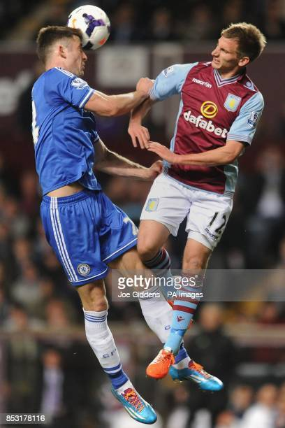 Chelsea's Gary Cahill and Aston Villa's Marc Albrighton during the Barclays Premier League match at Villa Park Birmingham