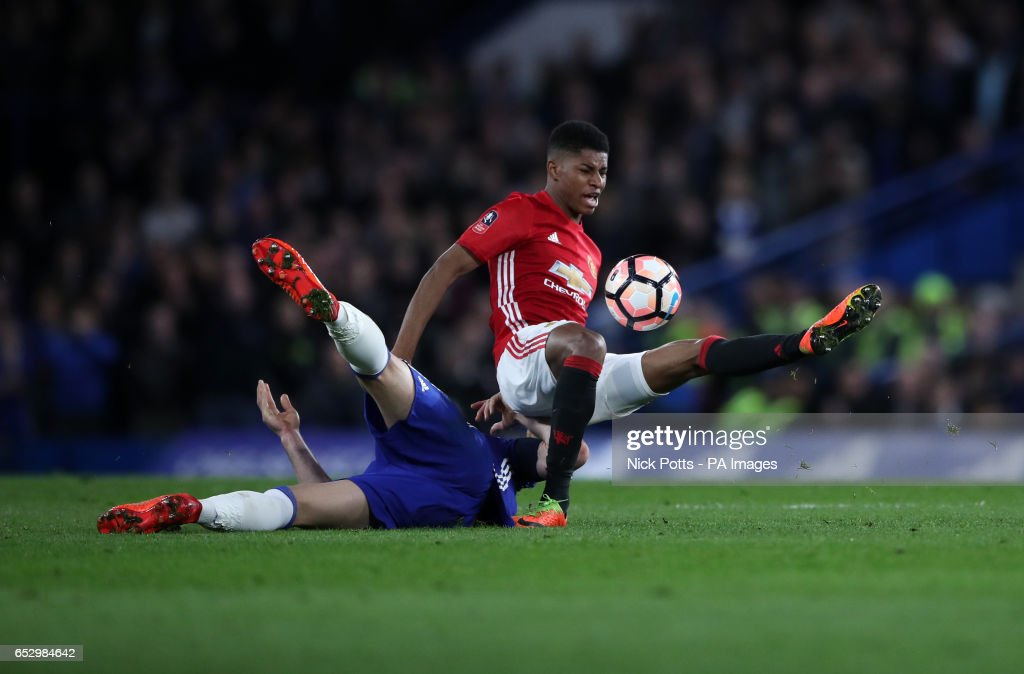 Chelsea's Gary Cahill and Manchester United's Marcus Rashford battle for the ball during the Emirates FA Cup, Quarter Final match at Stamford Bridge, London.