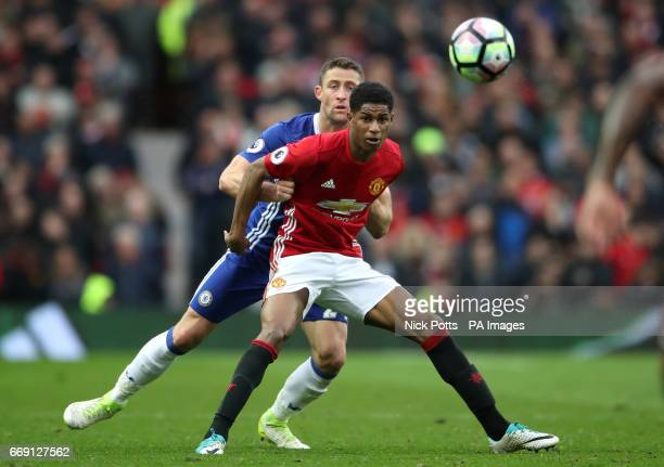 Chelsea's Gary Cahill and Manchester United's Marcus Rashford battle for the ball during the Premier League match at Old Trafford Manchester