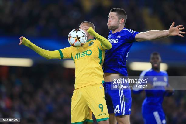Chelsea's Gary Cahill and Sporting Lisbon's Islam Slimani battle for the ball in the air