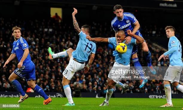 Chelsea's Gary Cahill battles for the ball with Manchester City's Vincent Kompany during the Barclays Premier League match at The Etihad Stadium...